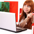 Foto Stock: Redhair woman with color shopping bags shopping over internet