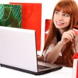Redhair woman with color shopping bags shopping over internet — Stock fotografie