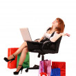 Redhair woman with color shopping bags shopping over internet — Stock Photo