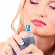 Young beautiful blonde woman with bottle of perfume isolated on — Stock Photo #7294213