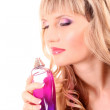 Young beautiful blonde woman with bottle of perfume isolated on — Stock Photo #7294215