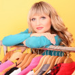 Happy young woman shopping for clothes at the shop — Stock Photo