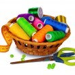 Bright threads in basket, scissors and measuring tape — Stock Photo #7294718