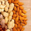 Nutmeg, peanuts, hazelnuts and almonds — Stock Photo