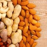 Nutmeg, peanuts, hazelnuts and almonds — Stock Photo