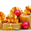 Beautiful gifts in gold packaging and Christmas balls isolated o — Stock Photo