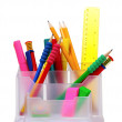 Pencils and pens in holder and the line — Stock Photo