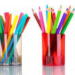 Stock Photo: Bright markers and crayons in holders