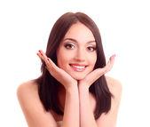 Hermosa joven sonriente con una piel sana y dientes grandes — Foto de Stock