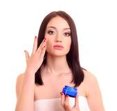 Beauty caucasian young woman applying cream — Stock Photo