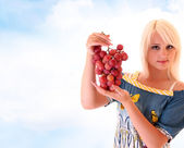 Blond woman with bunch of grapes — Stock Photo