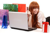 Beautiful, young, redhead woman with color shopping bags shoppin — Stock Photo