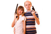 Woman and man with guns over white — Stock Photo