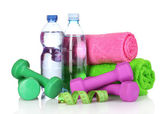 Towel, dumbbells and water bottle — Stock Photo