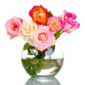 Beautiful bouquet of roses in transparent vase isolated on white — Stock Photo