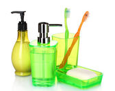 Green bathroom accessories and soap — Stock Photo