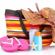 Stock Photo: Bright striped beach bag and beach items