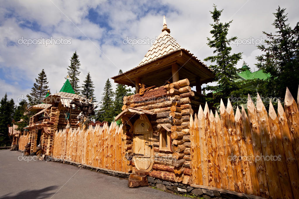 Wooden fence from theme park on the lake Zuratkul — Stock Photo #6836556