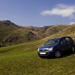 Stock Photo: Car on mountain slope