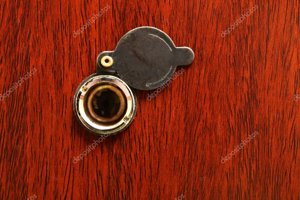 Peephole on wooden door - judas hole spyhole  Stock Photo #6858222