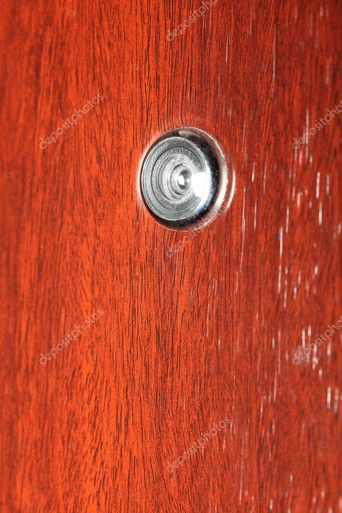 Peephole on wooden door - judas hole spyhole — Stock Photo #6859494