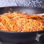 Постер, плакат: Boiling Spaghetti Pasta in a skillet