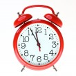 Red old style alarm clock isolated — 图库照片