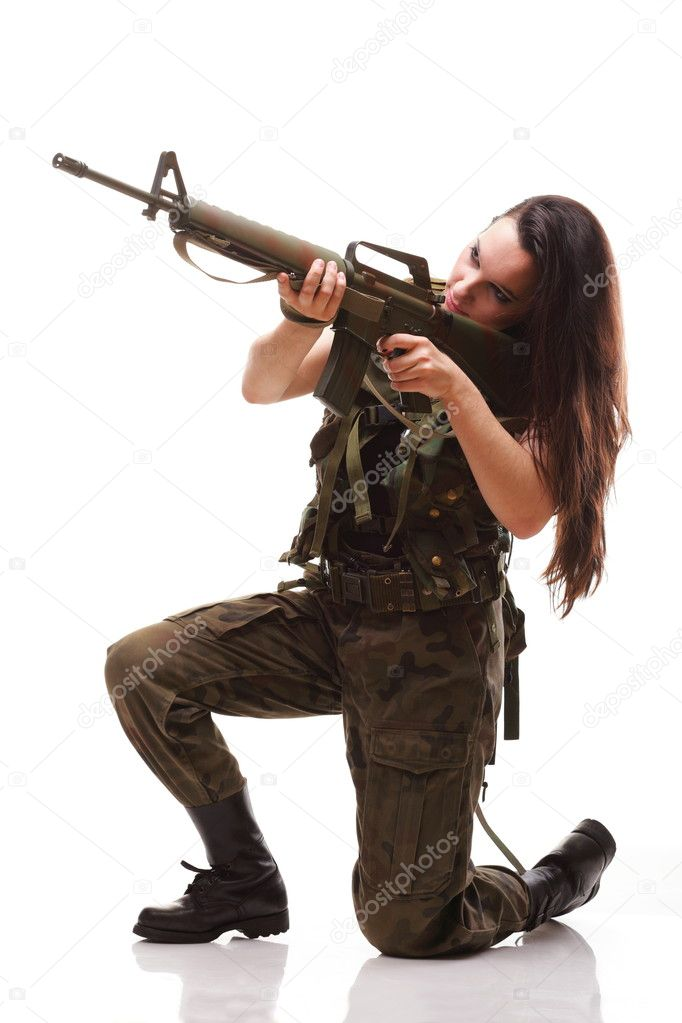 Beautiful woman with rifle plastic Military Army girl Holding Gun white isolated background — Stock Photo #7584559