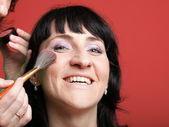 Kobieta farby twarz z makijażem — Zdjęcie stockowe