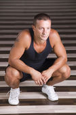 Young man relaxing in the gym... — ストック写真