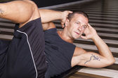 Fitness instructor doing sit-ups — Stock Photo