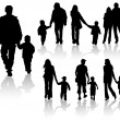 Stock Vector: Silhouettes of parents with children