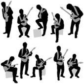 吉他弹奏者剪影 — 图库矢量图片