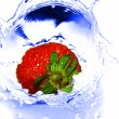 Strawberry in water — Stock Photo