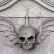 Skull carved in stone — 图库照片