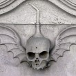 Skull carved in stone - Stock Photo