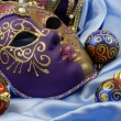 Beautiful Venetian mask on red velvet — Stock Photo