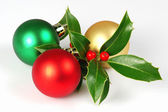 Christmas holly and balls — Stock Photo
