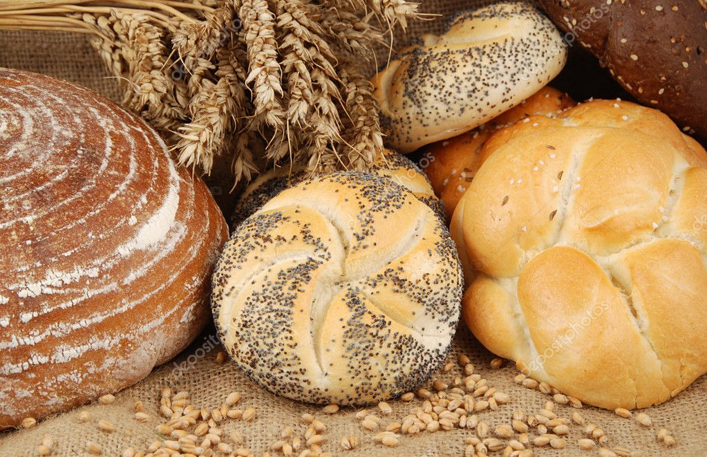 Various fresh baked goods with wheat grain and bundle — Stock Photo #6807408