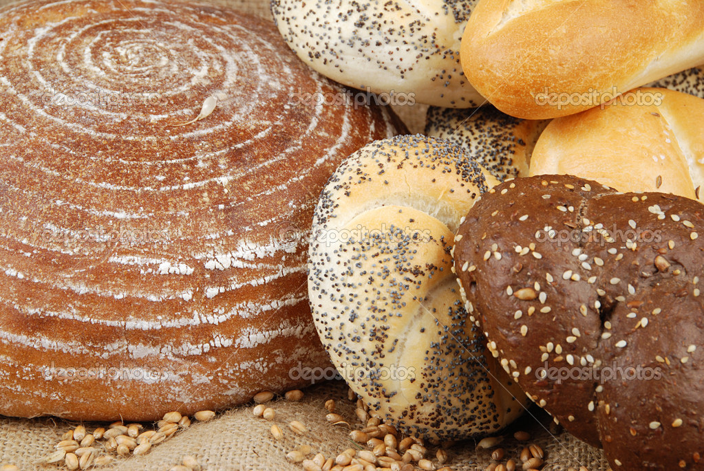 Various fresh baked goods with wheat grain — Stock Photo #6807410