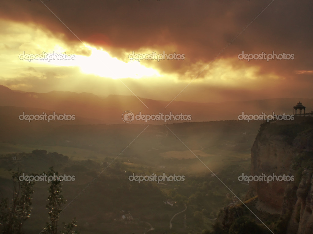 Beautiful sunset over andalucian town in Spain Ronda        Stock Photo #6807840