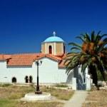 Greek church and palm — Stock Photo