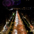 Champs Elysees at night and fireworks — Stock Photo