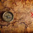 Compass and a map — Foto Stock