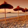 Umbrellas by the sunset — Stock Photo