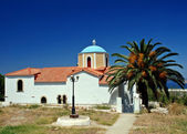 Greek church and palm — Stock Photo