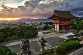 Beautiful dramatic sunset seen from the Kiyomizu-dera shrine above Kyoto, Japan. HDR — Foto de Stock
