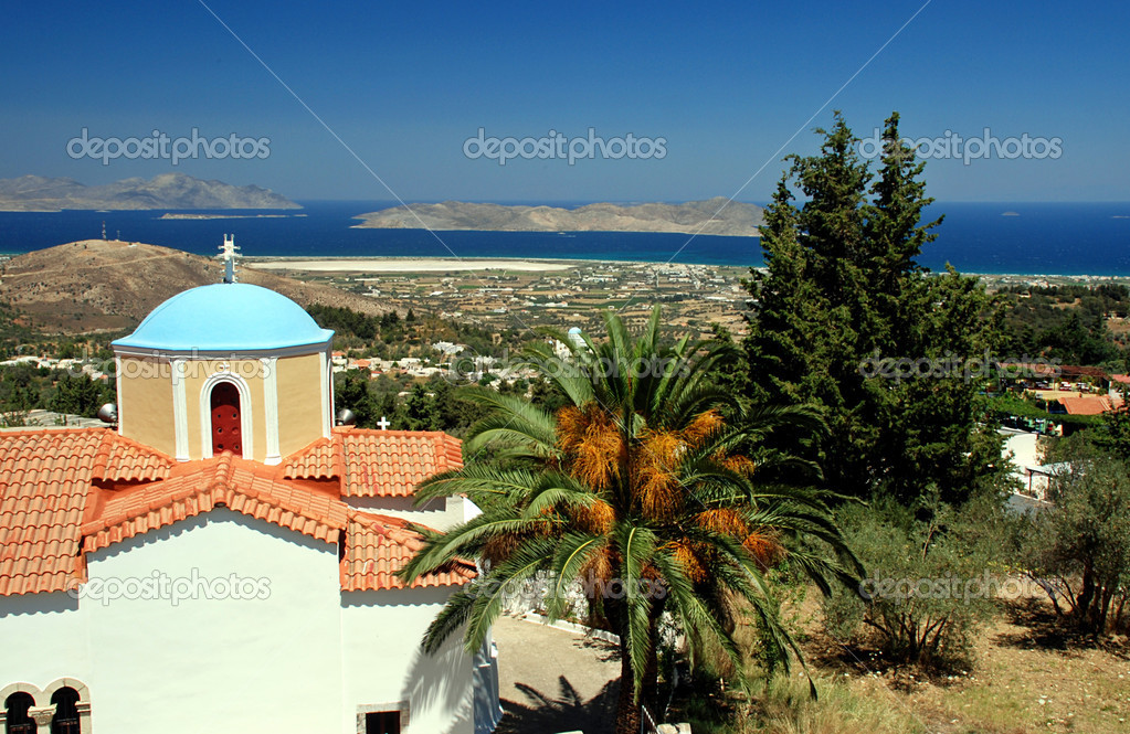 Greek orthodox church, lantern and palm with a view at sea  Stock Photo #6810159