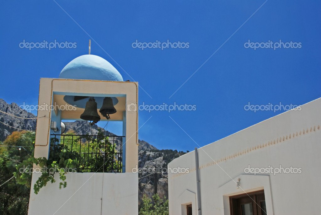 Belfry of the church in Zia - mountain village on Greek island Kos — Stock Photo #6810190