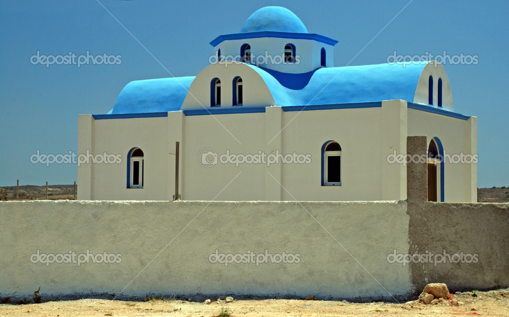 Typical Greek church - white walls and a blue cupola  Foto Stock #6810323